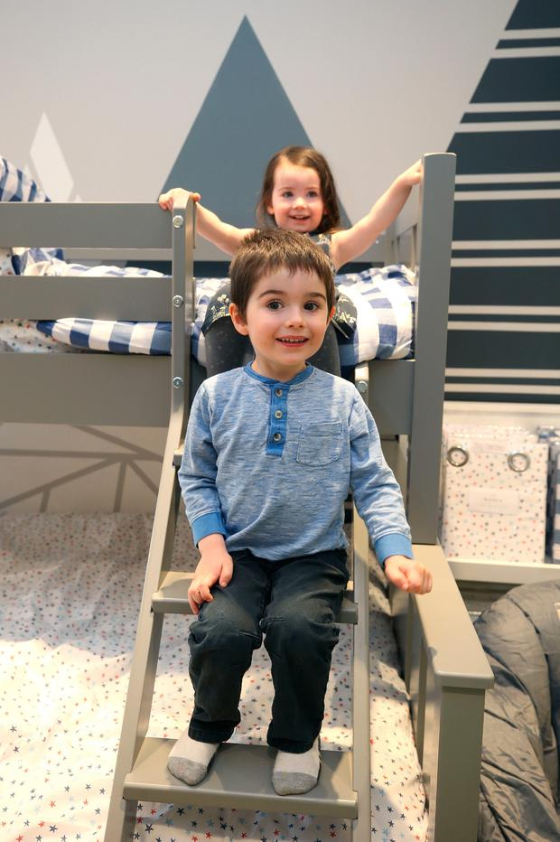 Ollie (4) and Anna Mae (2) Collins from Maynooth testing out bunk beds at the new store. Photo: Damien Eagers