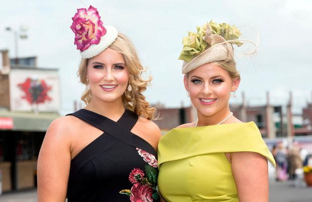 Sisters Kara and Shauna Ellis from Clarinbridge were at The Galway Races as sun, style and a selfie wall helped the festival get off to a galloping start. Photo: Tony Gavin