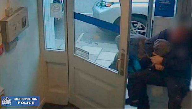 The moment a member of the public wrestled with an armed bank robber