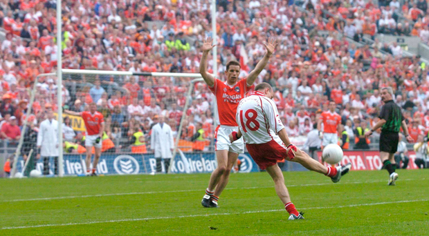 4 September 2005; Peter Canavan, Tyrone, kicks the winning point for victory over Armagh in injury time as Paul McGrane, Armagh, tries to block. Bank of Ireland All-Ireland Senior Football Championship Semi-Final, Armagh v Tyrone, Croke Park, Dublin. Picture credit; David Maher / SPORTSFILE