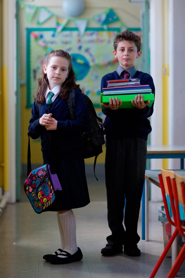 Jayna McCluskey (age 8) from Whitehall and Mark Araj (10) from Beaumont pose for the launch of the Barnardos School Costs Survey 2017