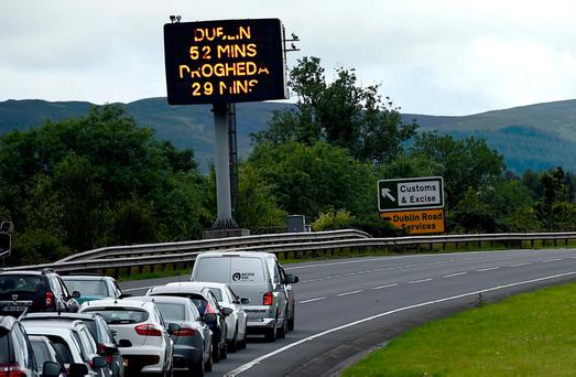 A sign for customs and excise is seen on the motorway approaching the border between Northern Ireland and Ireland, near Newry. Photo: REUTERS