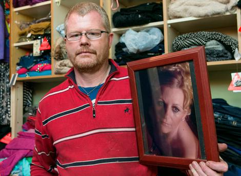 Richard Satchwell with a photo of his wife Tina, who is missing from their home in Youghal. Photo: Kyran O'Brien