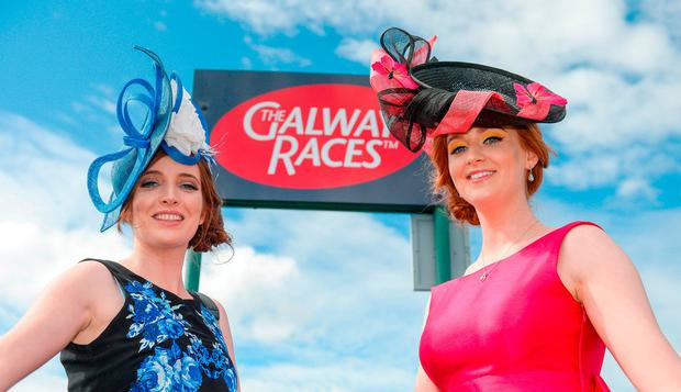 Twin sisters Rebecca Casserly, left, and Stephanie Casserly, from Oranmore, Co Galway, during the Galway Races Summer Festival 2017 at Ballybrit. Photo: Cody Glenn/Sportsfile