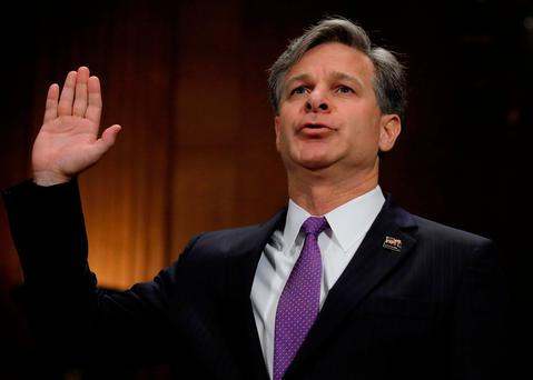 Christopher Wray is sworn in prior to testifying before a Senate Judiciary Committee confirmation hearing on his nomination to be the next FBI director on Capitol Hill in Washington, U.S. REUTERS/Carlos Barria/File Photo