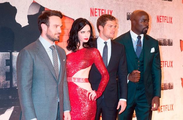 From left: Charlie Cox, Krysten Ritter, Finn Jones and Mike Colter arrive for the Netflix premiere of Marvel's