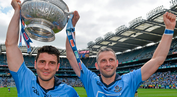 20 July 2014; Dublin forwards Bernard and Alan Brogan with the Delaney Cup after the game. Leinster GAA Football Senior Championship Final, Dublin v Meath, Croke Park, Dublin. Picture credit: Ray McManus / SPORTSFILE