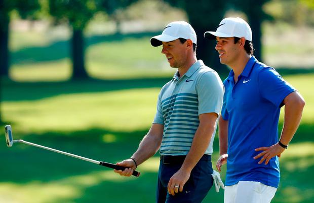 Rory McIlroy of Northern Ireland speaks to his new caddie Harry Diamond during a preview day of the World Golf Championships - Bridgestone Invitational at Firestone Country Club South Course in Akron, Ohio. (Photo by Sam Greenwood/Getty Images)
