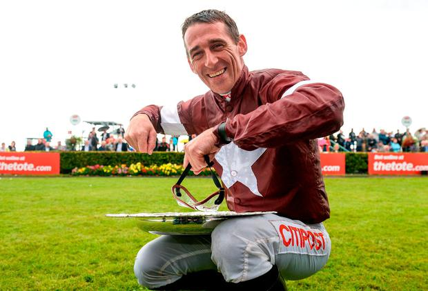 Jockey Davy Russell celebrates by pretending to eat his dinner off the Galway Plate after winning the The Tote.com Galway Plate on Balko Des Flos during the Galway Races Summer Festival 2017 at Ballybrit, in Galway. Photo by Cody Glenn/Sportsfile