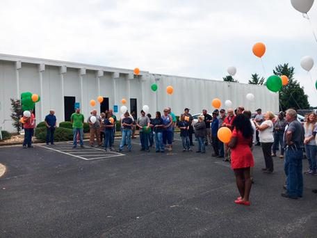 Jason Corbett was remembered by his former work colleagues at the MPS plant in North Carolina, who released green, white and orange balloons