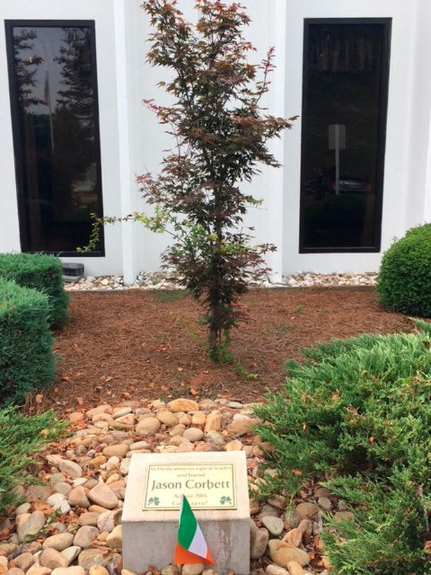 Jason Corbett was remembered by his former work colleagues at the MPS plant in North Carolina, who released green, white and orange balloons and have planted a tree with a plaque