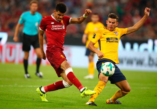 Liverpool's Dominic Solanke in action with Atletico Madrid's Lucas Hernandez. Photo: Reuters/Michael Dalder