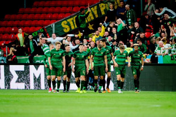 Celtic players celebrate James Forrest's goal. Photo: Reuters
