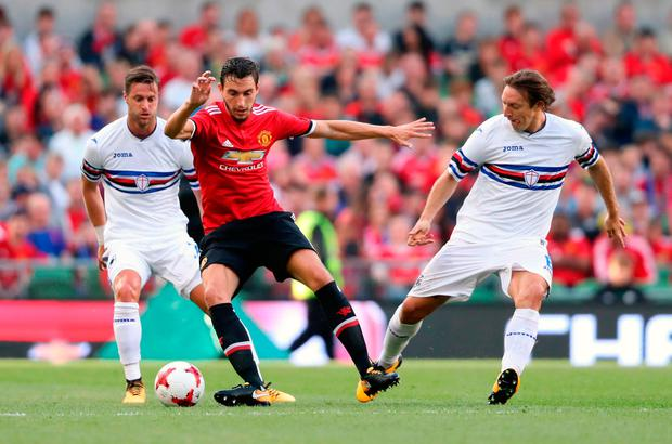 Manchester United's Matteo Darmian (centre) battles for the ball with Sampdoria's Jacopo Sala (left) and Edgar Barreto. Photo credit: Niall Carson/PA Wire