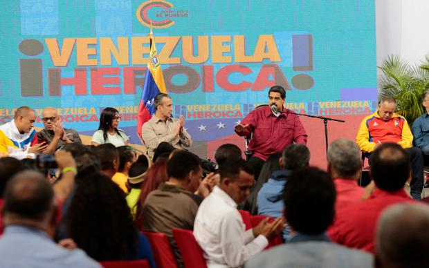 Venezuela's President Nicolas Maduro (2nd R) speaks during a meeting with members of the Constituent Assembly in Caracas, Venezuela August 2, 2017. The text in the back reads,