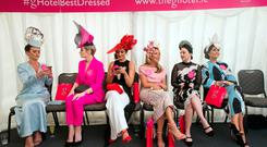 Finalists of the G Hotel Best Dressed Lady competition wait in the judges tent at The Galway Races on Ladies day, including eventual winner Aoife McCana (far left) Photo: Tony Gavin