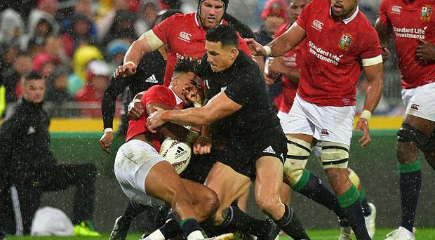 British and Irish Lions' Anthony Watson (L) is tackled by New Zealand All Blacks' Sonny Bill Williams during the second rugby union Test between the British and Irish Lions and the New Zealand All Blacks in Wellington on July 1, 2017.Photo credit - MARTY MELVILLE/AFP/Getty Images.