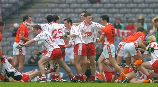 A classic example of how Tyrone and Armagh tempers can flare, from the 2005 Ulster final replay in Croke Park – that's me on the ground on the far left being pulled from the melee. Photo: Brendan Moran / Sportsfile