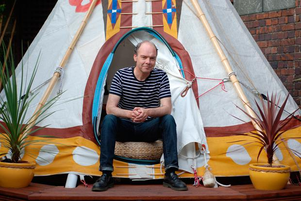 Ciaran Adamson next to the teepee in his back garden