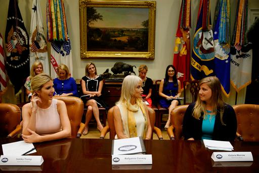 White House advisors Ivanka Trump and Kellyanne Conway with the wife of a US Marine, Victoria Morrow, during a listening session with military spouses in Washington. Photo: Jonathan Ernst/Reuters
