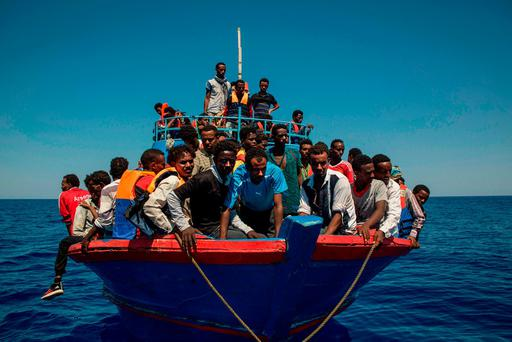 Migrants wait to be rescued in the Mediterranean Sea, 30 nautical miles from Libya. Photo: Angelos Tzortzinis/AFP/Getty Images