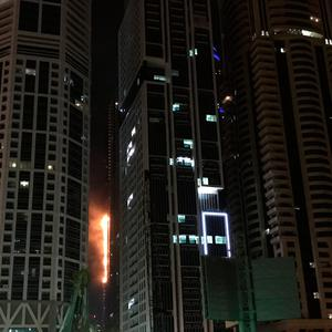 Flames shoot up the side of the Torch tower residential building in the Marina district, Dubai, United Arab Emirates, in this August 4, 2017. REUTERS/Abed Al Hadi Al Ramahi NO RESALES. NO ARCHIVES