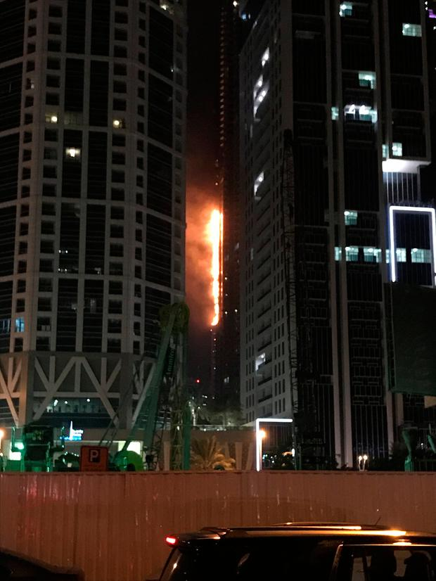 Flames shoot up the side of the Torch tower residential building in the Marina district, Dubai, United Arab Emirates, August 4, 2017. REUTERS/Abed Al Hadi Al Ramahi