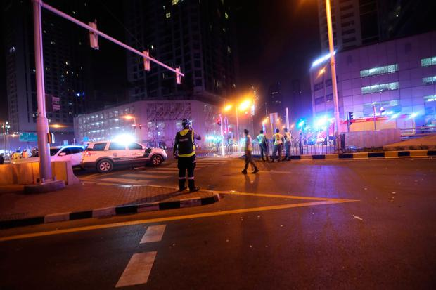 Dubai Emergency Response teams and Dubai police are seen on the street near Dubai's Torch tower residential building in the Marina district, Dubai, United Arab Emirates, early hours of August 4, 2017. REUTERS/Hamad I Mohammed