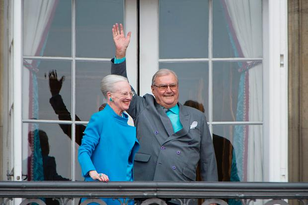 Danish Queen Margrethe and Prince Henrik greet well-wishers from the balcony on the occasion of the Queen's 76th Birthday celebration at Amalienborg Palace in Copenhagen on April 16, 2016. / AFP / Scanpix Denmark / Marie Hald / Denmark
