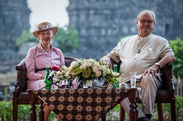 Queen Margrethe II of Denmark and her husband, Prince Henrik talk to journalist during their visit at Prambanan temple on October 24, 2015 in Yogyakarta, Indonesia