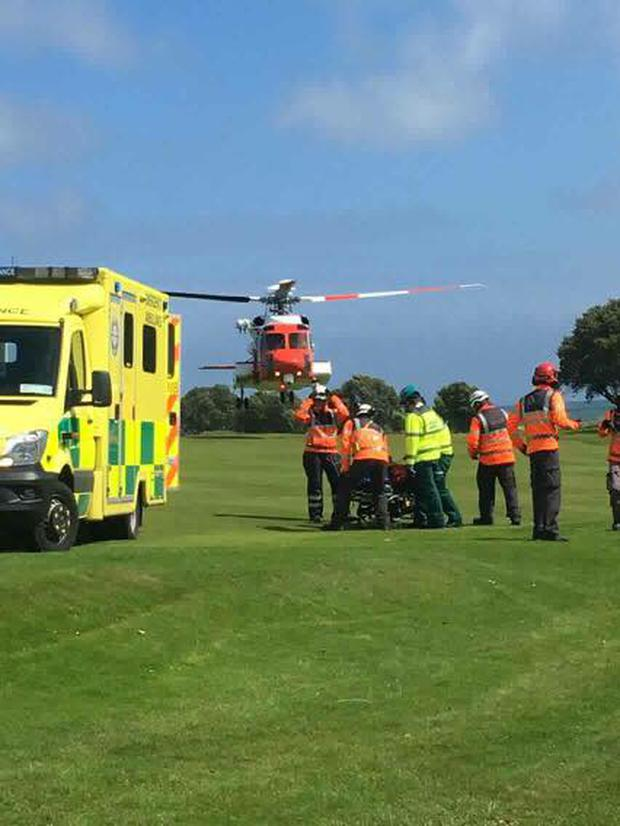 Ambulance crew and a helicopter arrive at the scene. Photo: Rescue 117 / Facebook
