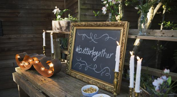 The personalised hashtag has become part of today's plugged-in weddings. Stock photo via Getty Images/Hero Images