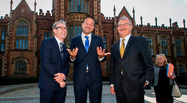 Taoiseach Leo Varadkar (centre) is greeted by Professor David Jones (left) and Queen's University President and Vice-Chancellor James McElnay as he arrives at the university in Belfast to make a speech on his first visit to Northern Ireland: Liam McBurney/PA Wire