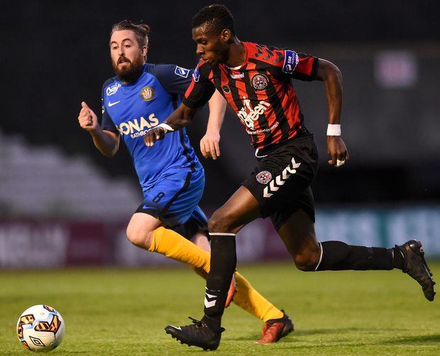 Ismahil Akinade of Bohemians in action against Mark Salmon of Bray Wanderers. Photo: Sportsfile