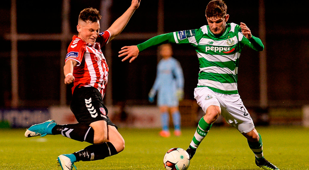 Derry City's Connor McDermott attempts to tackle Shamrock Rovers' Trevor Clarke during last night's Premier Division clash at Tallaght Stadium Photo: Piaras Ó Mídheach/Sportsfile