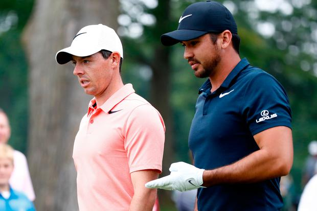Rory McIlroy and Jason Day walk to the third tee during the second round of the World Golf Championships in Akron, Ohio. (Photo by Gregory Shamus/Getty Images)