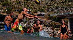 People cool off in the Cijevna river near Tuzi as a heatwave hits Montenegro. REUTERS/Stevo Vasiljevic