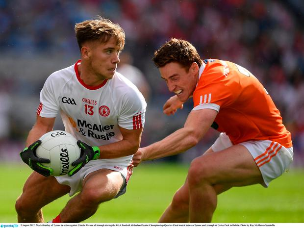 Mark Bradley of Tyrone in action against Charlie Vernon of Armagh