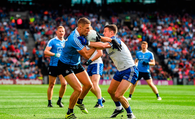 Paul Mannion of Dublin in action against Ryan Wylie of Monaghan