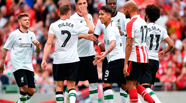Roberto Firmino of Liverpool is congratulated by his team-mates, from left, Alberto Moreno, James Milner, Marko Grujic, Divock Origi and Mohamed Salah