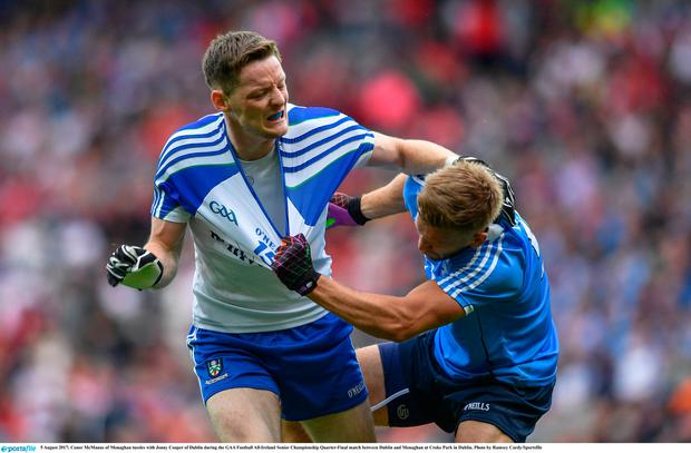 Conor McManus of Monaghan tussles with Jonny Cooper of Dublin