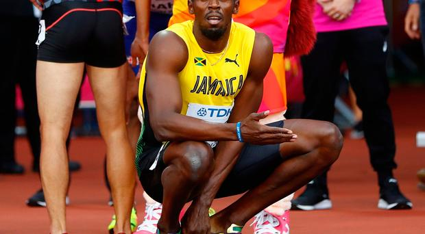 Usain Bolt of Jamacia waits for official results after the heat
