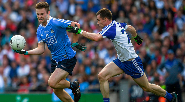 Dublin's Jack McCaffrey gets away from Karl O'Connell of Monaghan during the SFC quarter-final in Croke Park last night. Photo: Sportsfile