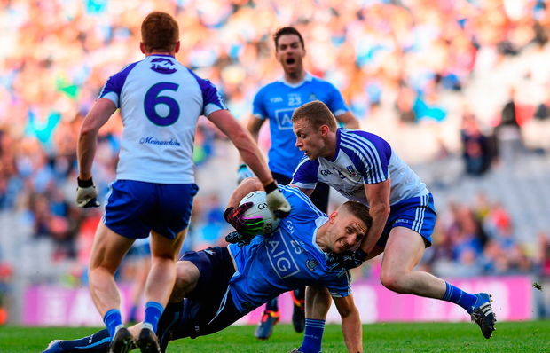 Eoghan O'Gara of Dublin in action against Colin Walshe of Monaghan