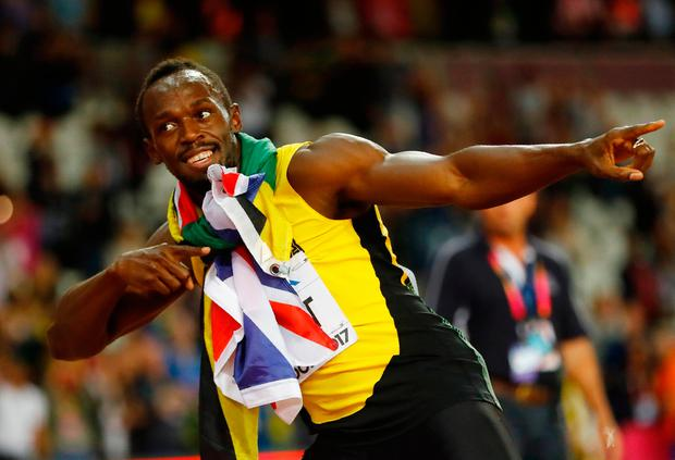 Usain Bolt of Jamaica reacts after the race