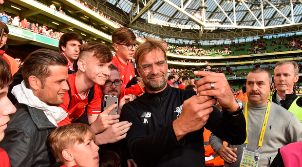 Liverpool manager Jurgen Klopp with supporters after the game