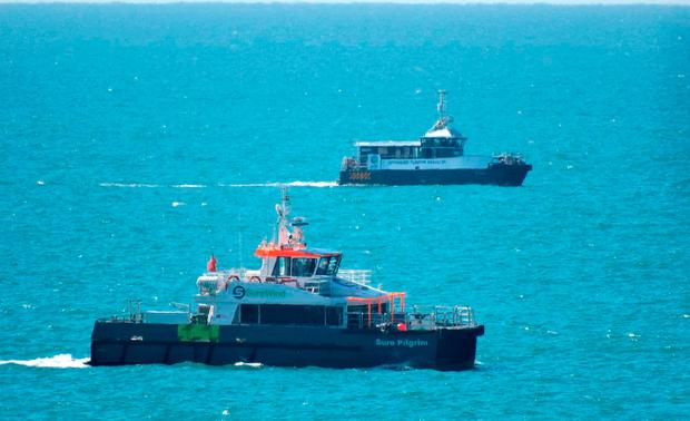Photo taken with permission from the Twitter feed of Oliver Button @OBDroning of the rescue, as one man has died after a boat sank in the English Channel off the Sussex coast Credit: Oliver Button/PA Wire