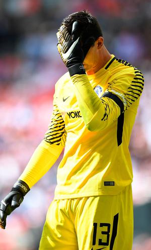 Chelsea's Thibaut Courtois reacts after missing a penalty