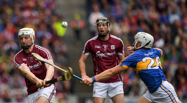 Joe Canning of Galway, under pressure from Niall O'Meara of Tipperary, hits over what proved to be the winning point in the last minute of the GAA Hurling All-Ireland Senior Championship Semi-Final match between Galway and Tipperary at Croke Park in Dublin. Photo by Ray McManus/Sportsfile