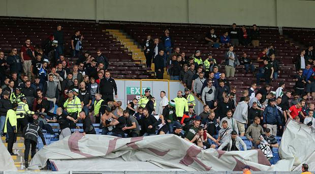 Fans of Hannover 96 move the seat covers during the Pre-Season Friendly between Burnley and Hannover 96 at Turf Moor on August 5, 2017 in Burnley, England. (Photo by Robbie Jay Barratt - AMA/Getty Images)